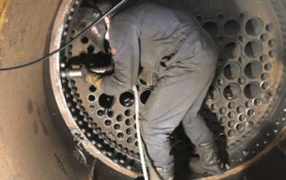 Rory Edwards at work in the smokebox riveting it to the boiler barrel. 07 February 2020 © George Balsdon