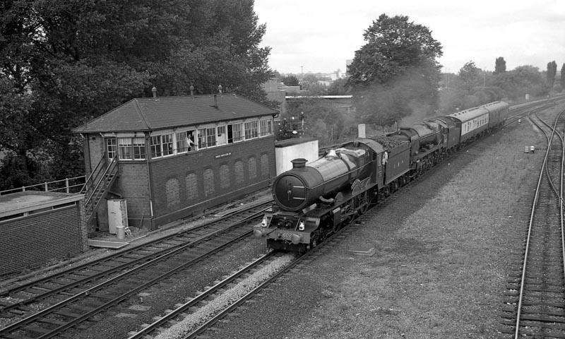 An unusual pairing, No. 6024 and No. 34027 Taw Valley pass Banbury North Signalbox, 20 August 1993. © Ian McDonald