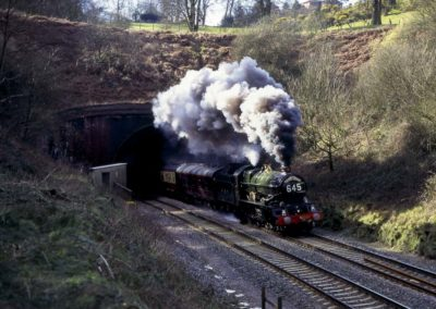 No. 6024 bursts out of Whiteball tunnel, 25 February 1995. © Martyn Bane