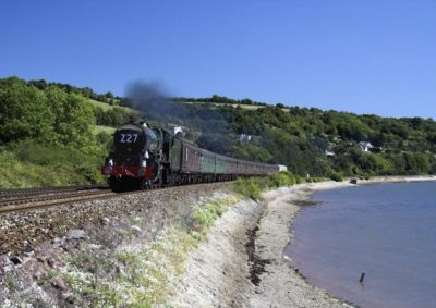 No. 6024 leads the 'Torbay Express' along the estuary beyonf Teignmouth, 28 August 2005. © Brian Bane