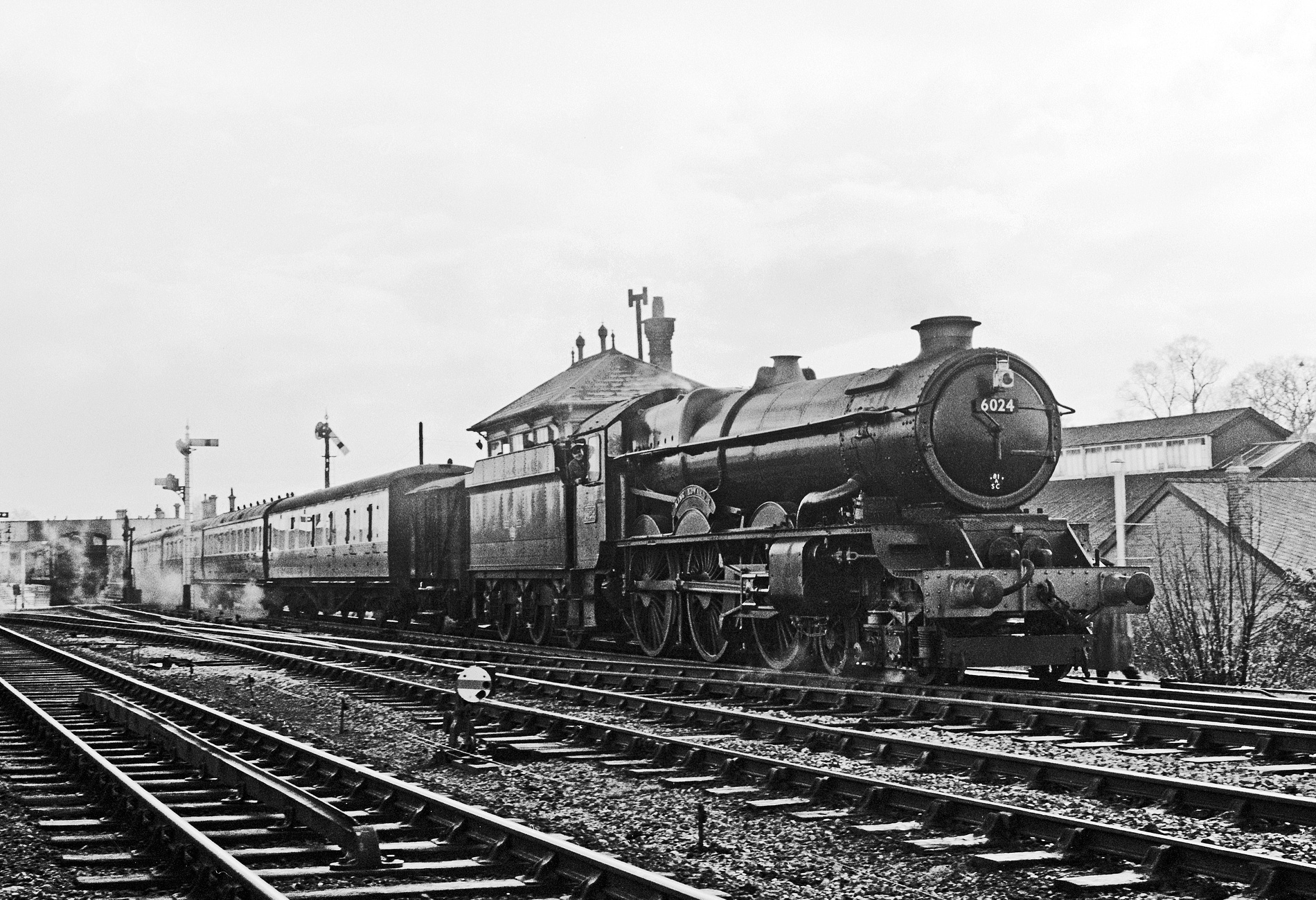 No. 6024 on a running in turn from Swindon works at Chippenham. It was normal for ex-works locomotives to run in on local trains between Swindon and Bristol., November 1958. © Rail Photoprints