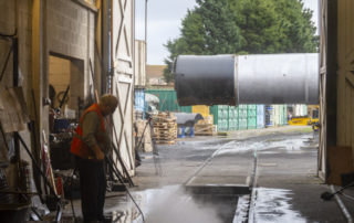 Nick Parry hard at work cleaning the pit as the boiler lurks outside. © Martyn Bane