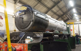 Looking more like a loco now with plenty of signs of progress – the smokebox is riveted to the barrel, lagging was being trial fitted, the handrails are (temporarily) on and cladding sheets stand waiting for their next coats of paint. 28 February 2020 © Martyn Bane