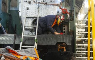 Nigel Day takes a gas torch to the cab sub floor to make room for more air pipes. 01 March 2020 © Martyn Bane