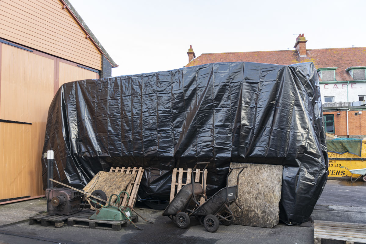 The tender, which has had to be put back outdoors following painting, has been clad and a large and very heavy tarpaulin. We hope this will keep the worst of the winter weather off and not go for a trip around Minehead yard on a windy evening! 08 December 2020 © Martyn Bane