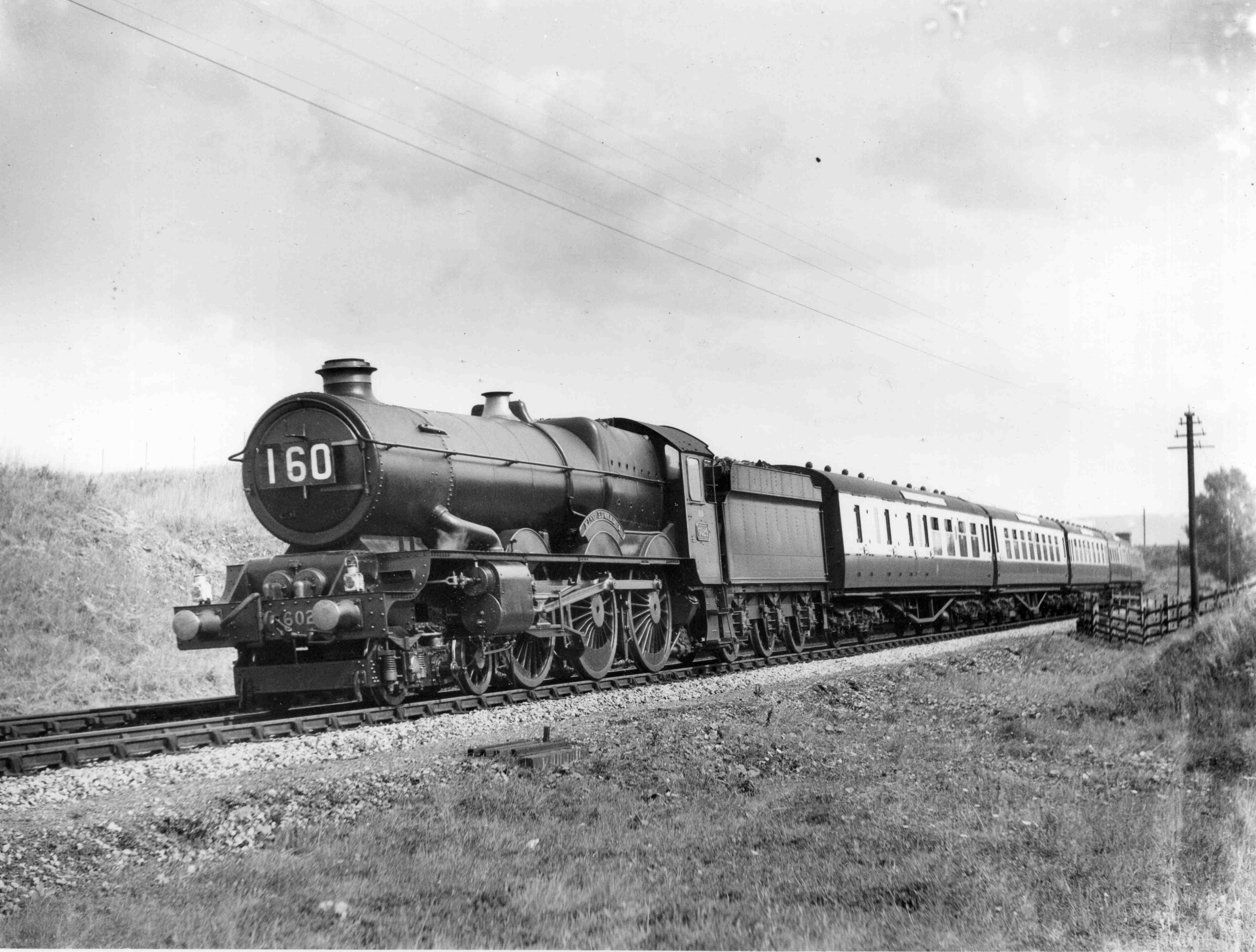No. 6024 on the then relatively new Westbury avoiding line with the down 'Torbay Express', mid 1930s. © NRM Collection