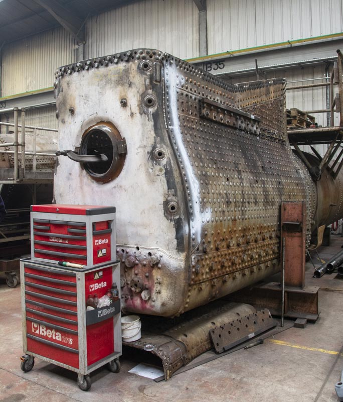 Boiler No. 8910 at Riley and Sons works turned upside down to make the work in hand easier. Prominent is the new 3/4 backhead sheet, 15 April 2018. © Martyn Bane