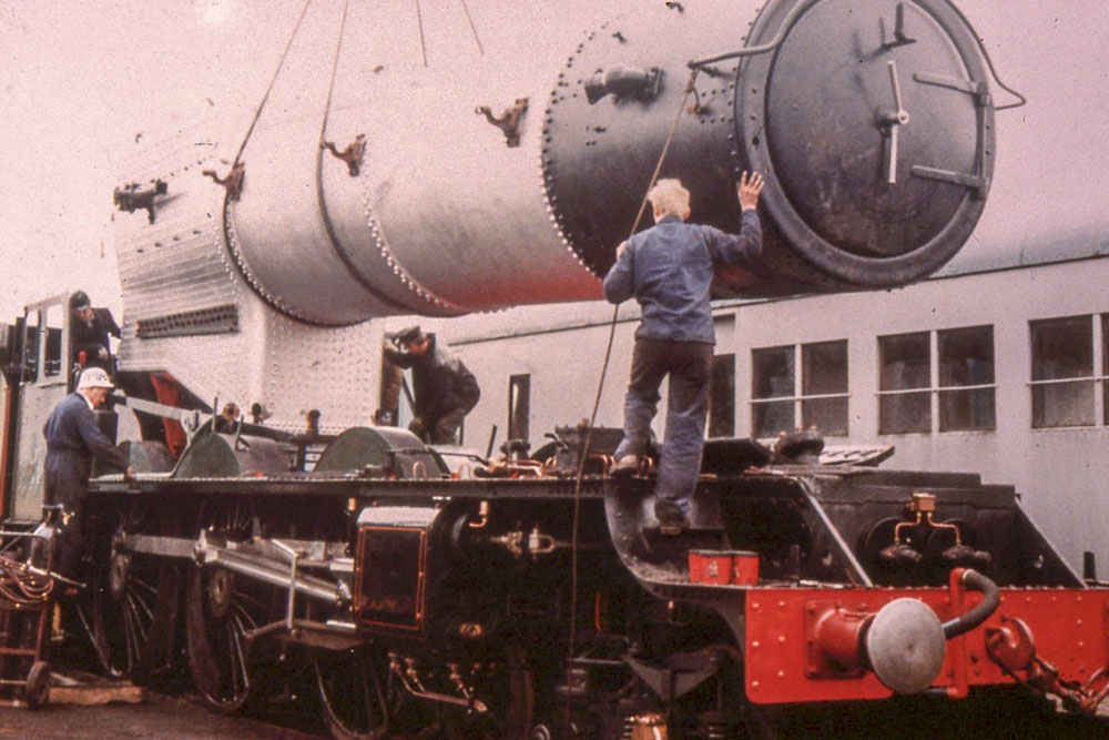 Boiler No. 8610 is returned to the chassis of No. 6024, 28 March 1988. © Unknown, please contact us if you know the photographer