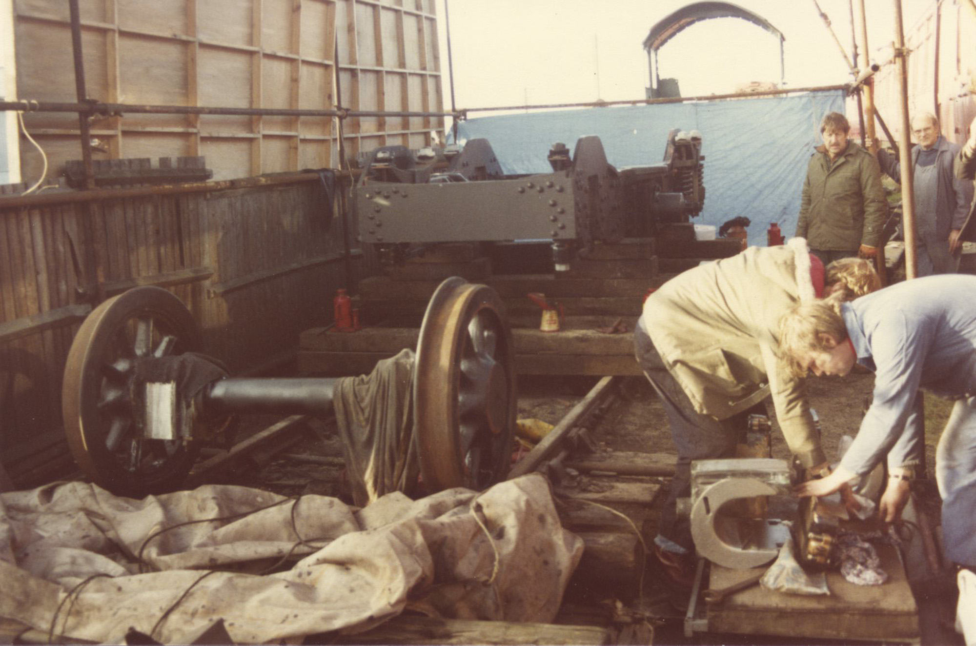 Working on the bogie, 1980s. © Chris Brown