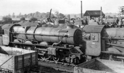 A withdrawn No. 6024 at Swindon dump in the company of No. 6023, 1963. © Chris Newman