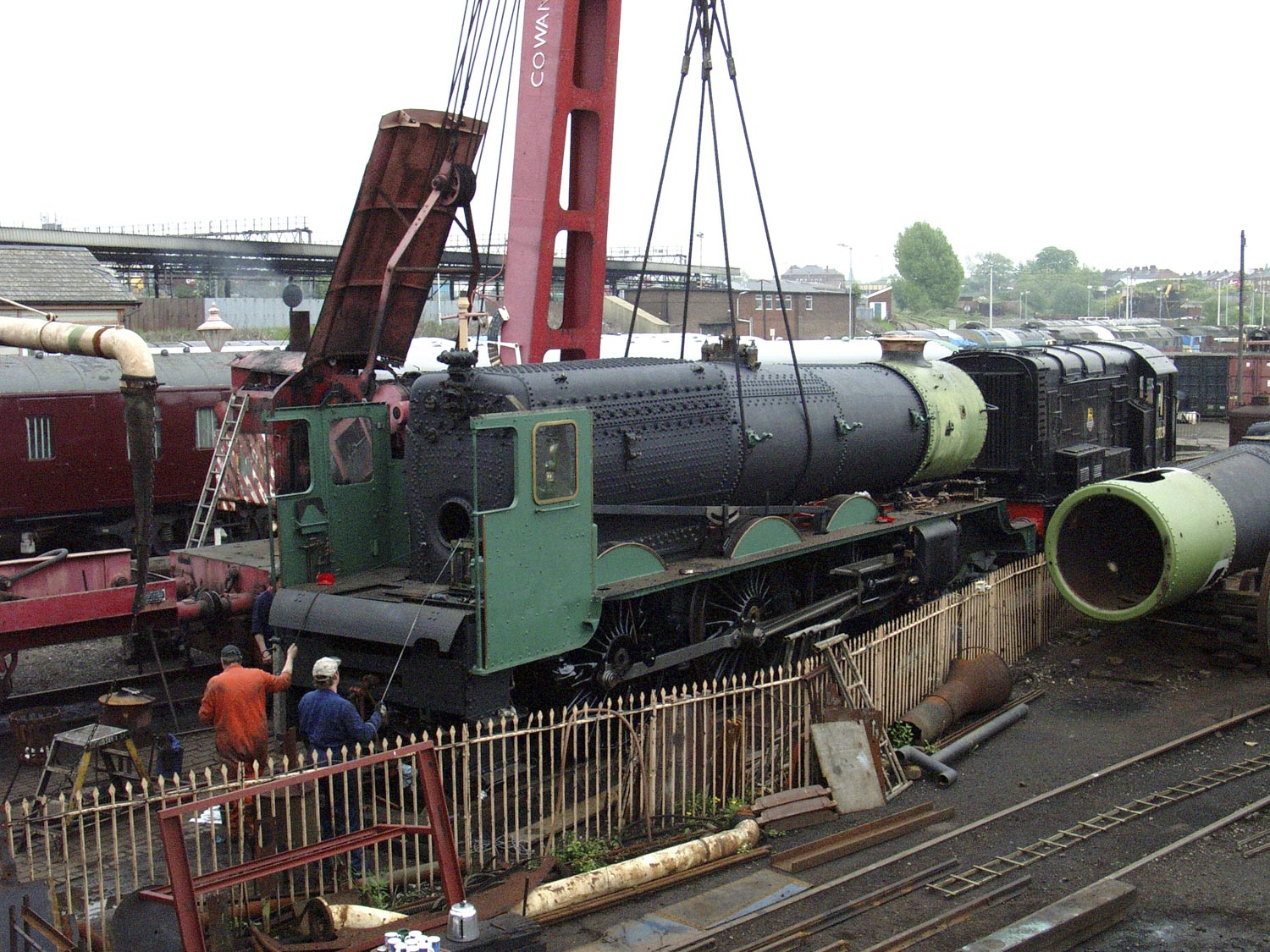 The overhauled boiler goes back in the frames at Tyseley with the aid of the steam crane, 11 May 2004. © Martyn Bane