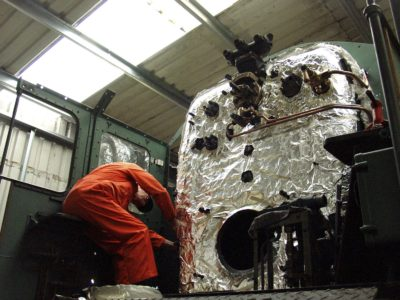 No. 6024 under overhaul at Tyseley with the boiler cad in foil to improve the level of insulation, 29 May 2004. © Martyn Bane