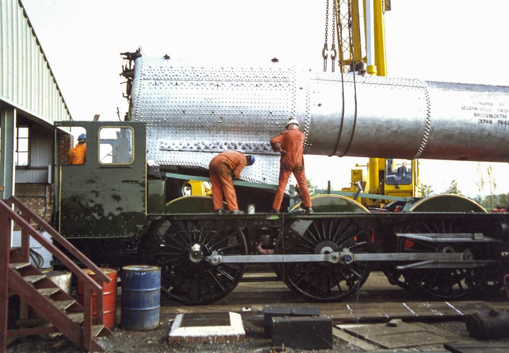 Boiler No. 8610 goes back into the frames of No. 6024 at BAD Kineton, 1996. © Bob Robson/6024 PS Ltd